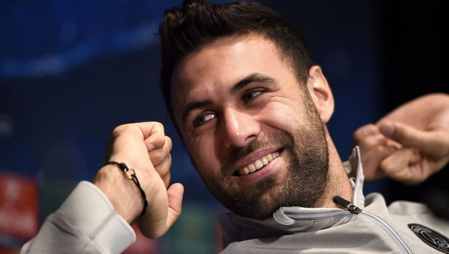 Paris Saint-Germain's goalkeeper Salvatore Sirigu smiles during a press conference at the Parc des Princes stadium in Paris on November 24, 2014, on the eve of the UEFA Champions League football match against Ajax Amsterdam. AFP PHOTO / FRANCK FIFE        (Photo credit should read FRANCK FIFE/AFP/Getty Images)