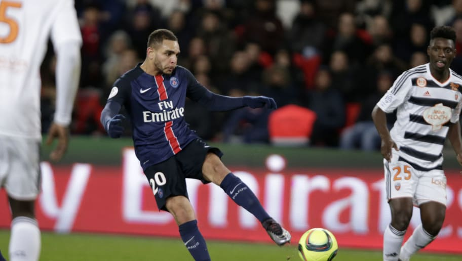 Paris Saint-Germain's French defender Layvin Kurzawa shoots  the ball during the French L1 football match Paris Saint-Germain (PSG) vs FC Lorient on February 03, 2016 at the Parc des Princes stadium in Paris. / AFP / KENZO TRIBOUILLARD        (Photo credit should read KENZO TRIBOUILLARD/AFP/Getty Images)