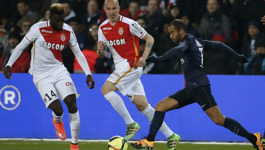 Paris Saint-Germain's Brazilian midfielder Lucas Moura (R) advances with the ball past AS Monaco's French midfielder Tiemoue Bakayoko (L) and Italian defender Andrea Raggi during the French L1 football match between Paris Saint-Germain and Monaco at the Parc des Princes stadium in Paris on March 20, 2016.  AFP PHOTO / THOMAS SAMSON / AFP / THOMAS SAMSON        (Photo credit should read THOMAS SAMSON/AFP/Getty Images)