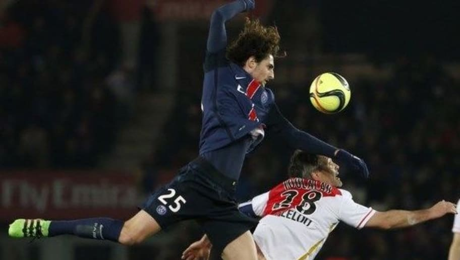 Paris Saint-Germain's French midfielder Adrien Rabiot (L) challenges Monaco's French midfielder Jeremy Toulalan (R) during the French L1 football match between Paris Saint-Germain (PSG) and AS Monaco at the Parc des Princes stadium in Paris on March 20, 2016