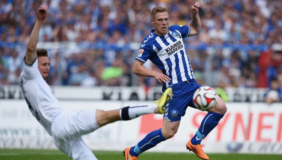 KARLSRUHE, GERMANY - MAY 24: Rouwen Hennings of Karlsruhe scores his team's first goal  during the Second Bundesliga match between Karlsruher SC and 1860 Muenchen the at Wildpark Stadium on May 24, 2015 in Karlsruhe, Germany.  (Photo by Matthias Hangst/Bongarts/Getty Images)