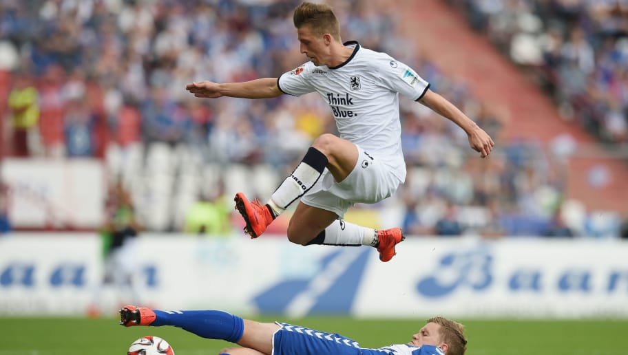 KARLSRUHE, GERMANY - MAY 24: Krisztian Simon of 1860 Muenchen and Philipp Max of Karlsruhe compete for the ball during the Second Bundesliga match between Karlsruher SC and 1860 Muenchen the at Wildpark Stadium on May 24, 2015 in Karlsruhe, Germany.  (Photo by Matthias Hangst/Bongarts/Getty Images)