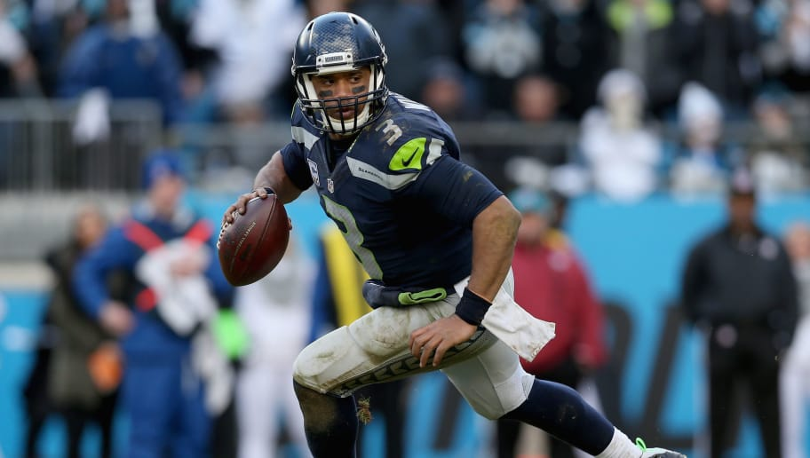 CHARLOTTE, NC - JANUARY 17:  Russell Wilson #3 of the Seattle Seahawks scrambles from the Carolina Panthers in the 4th quarter during the NFC Divisional Playoff Game at Bank of America Stadium on January 17, 2016 in Charlotte, North Carolina.  (Photo by Patrick Smith/Getty Images)