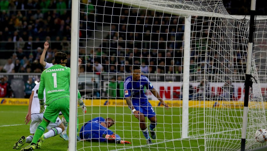 MOENCHENGLADBACH, GERMANY - OCTOBER 25: Andreas Christensen of Moenchengladbach (L) scores an own goal during the Bundesliga match between Borussia Moenchengladbach and FC Schalke 04 at Borussia-Park on October 25, 2015 in Moenchengladbach, Germany.  (Photo by Christof Koepsel/Bongarts/Getty Images)