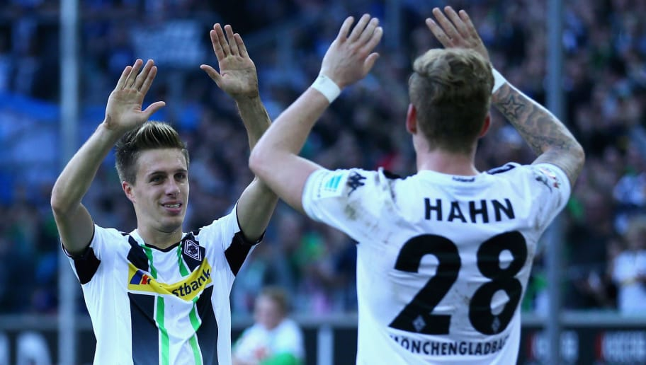 MOENCHENGLADBACH, GERMANY - NOVEMBER 02: (L-R) Patrick Herrmann of Moenchengladbach celebrates the second goal with Andre Hahn during the Bundesliga match between Borussia Moenchengladbach and 1899 Hoffenheim at Borussia Park Stadium on November 2, 2014 in Moenchengladbach, Germany.  (Photo by Christof Koepsel/Bongarts/Getty Images)