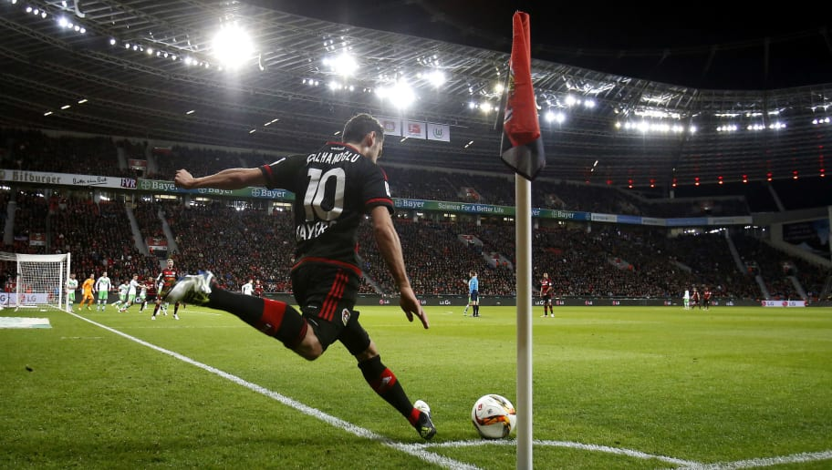 LEVERKUSEN, GERMANY - APRIL 01:  Hakan Calhanoglu of Leverkusen with a corner kick during the Bundesliga match between Bayer Leverkusen and VFL Wolfsburg at BayArena on April 1, 2016 in Leverkusen, Germany.  (Photo by Mika Volkmann/Bongarts/Getty Images)