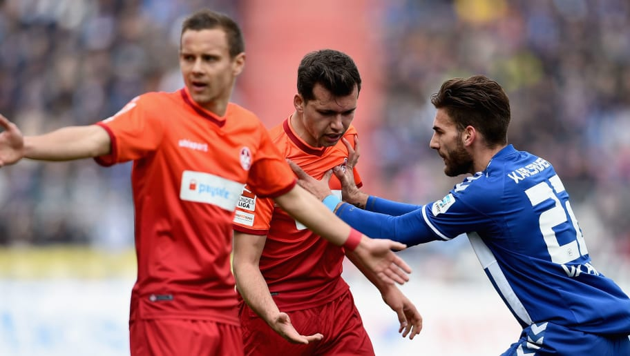 KARLSRUHE, GERMANY - MARCH 22:  Kevin Stoeger of 1. FC Kaiserslautern is pushed back by Enrico Valentini of Karlsruher SC during the Second Bundesliga match between Karlsruher SC and 1. FC Kaiserslautern at Wildpark Stadium on March 22, 2015 in Karlsruhe, Germany.  (Photo by Dennis Grombkowski/Bongarts/Getty Images)