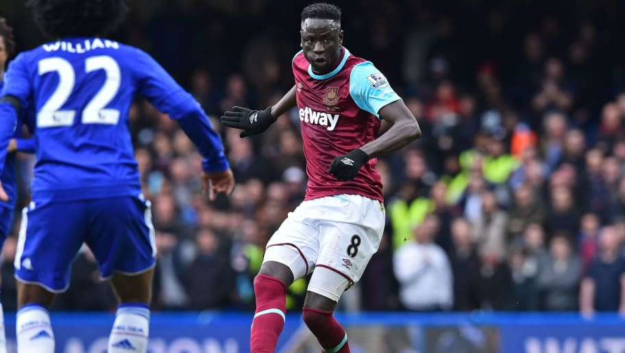 West Ham United's Senegalese midfielder Cheikhou Kouyate passes the ball during the English Premier League football match between Chelsea and West Ham United at Stamford Bridge in London on March 19, 2016. The game finished 2-2. / AFP / Ben STANSALL / RESTRICTED TO EDITORIAL USE. No use with unauthorized audio, video, data, fixture lists, club/league logos or 'live' services. Online in-match use limited to 75 images, no video emulation. No use in betting, games or single club/league/player publications.  /         (Photo credit should read BEN STANSALL/AFP/Getty Images)