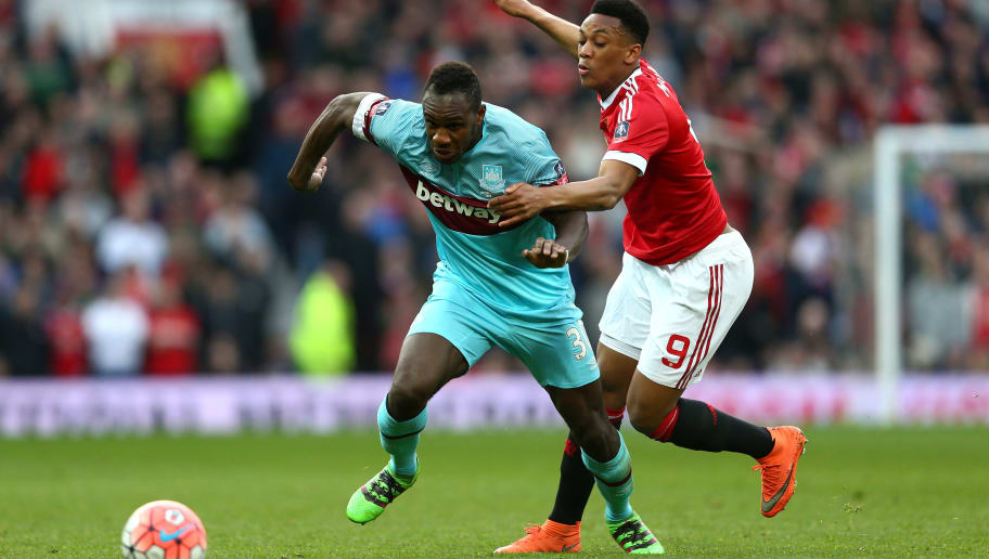MANCHESTER, ENGLAND - MARCH 13:  Michail Antonio of West Ham United evades Anthony Martial of Manchester United during the Emirates FA Cup sixth round match between Manchester United and West Ham United at Old Trafford on March 13, 2016 in Manchester, England.  (Photo by Clive Brunskill/Getty Images)