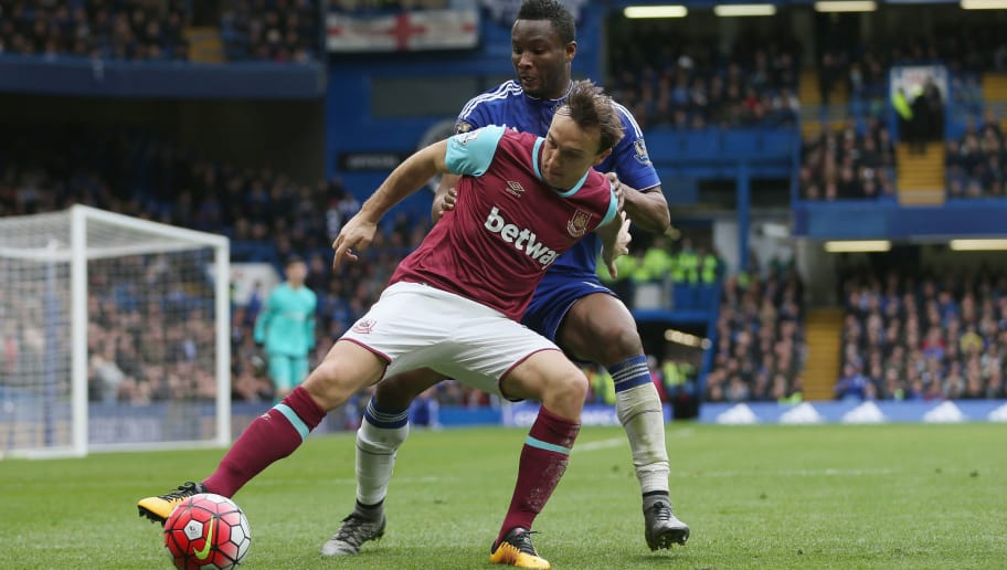 LONDON, ENGLAND - MARCH 19:  Mark Noble of West Ham United holds off John Obi Mikel of Chelsea during the Barclays Premier League match between Chelsea and West Ham at Stamford Bridge on March 19, 2016 in London, United Kingdom.  (Photo by Alex Morton/Getty Images)
