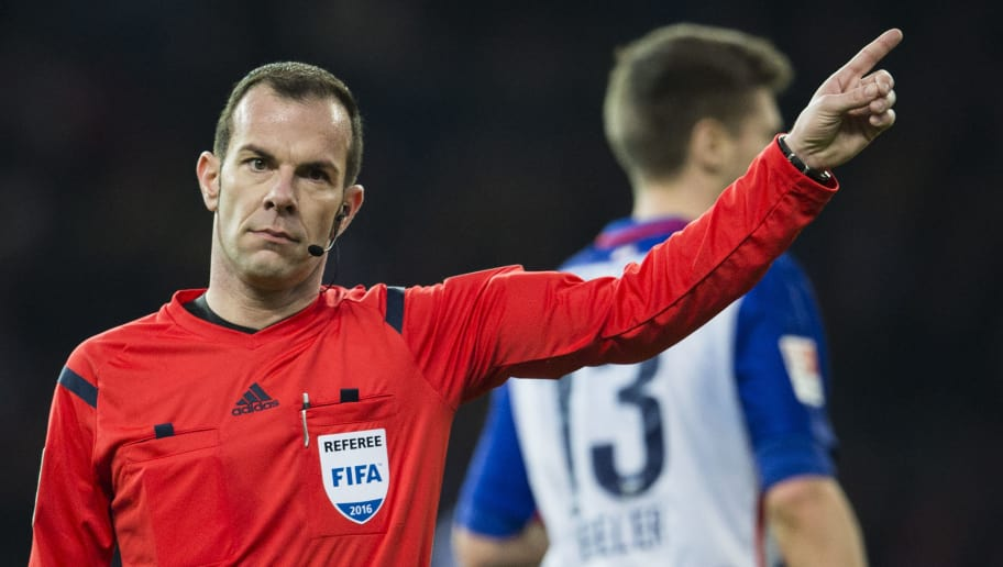 Referee Marco Fritz gestures during the German first division Bundesliga football match, Hertha Berlin v Borussia Dortmund, at the Olympic stadium in Berlin on February 6, 2016.  / AFP / ODD ANDERSEN / RESTRICTIONS: DURING MATCH TIME: DFL RULES TO LIMIT THE ONLINE USAGE TO 15 PICTURES PER MATCH AND FORBID IMAGE SEQUENCES TO SIMULATE VIDEO. == RESTRICTED TO EDITORIAL USE == FOR FURTHER QUERIES PLEASE CONTACT DFL DIRECTLY AT + 49 69 650050         (Photo credit should read ODD ANDERSEN/AFP/Getty Images)