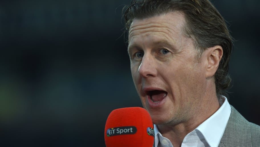 Former Liverpool player Steve Mcmanaman, now a TV pundit, broadcasting ahead of the English FA Cup quarter-final replay football match between Blackburn Rovers and Liverpool at Ewood Park in Blackburn, north west England on April 8, 2015. AFP PHOTO / PAUL ELLIS  RESTRICTED TO EDITORIAL USE. NO USE WITH UNAUTHORIZED AUDIO, VIDEO, DATA, FIXTURE LISTS, CLUB/LEAGUE LOGOS OR LIVE SERVICES. ONLINE IN-MATCH USE LIMITED TO 45 IMAGES, NO VIDEO EMULATION. NO USE IN BETTING, GAMES OR SINGLE CLUB/LEAGUE/PLAYER PUBLICATIONS.        (Photo credit should read PAUL ELLIS/AFP/Getty Images)