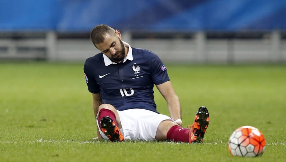 France's forward Karim Benzema reacts after being injured during the friendly football match between France and Armenia on October 8, 2015 at the Allianz Riviera stadium in Nice, southeastern France. AFP PHOTO / VALERY HACHE        (Photo credit should read VALERY HACHE/AFP/Getty Images)