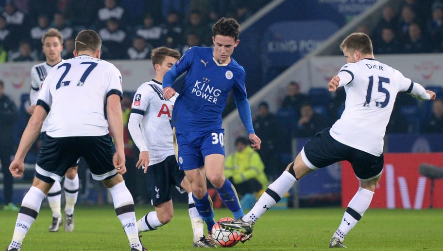 Leicester City's English defender Ben Chilwell (2nd R) is surrounded by Tottenham players during the English FA Cup third round replay football match between Leicester City v Tottenham Hotspur at King Power Stadium in Leicester, central England on January 20, 2016. AFP PHOTO / OLI SCARFF  RESTRICTED TO EDITORIAL USE. No use with unauthorized audio, video, data, fixture lists, club/league logos or 'live' services. Online in-match use limited to 75 images, no video emulation. No use in betting, games or single club/league/player publications. / AFP / OLI SCARFF        (Photo credit should read OLI SCARFF/AFP/Getty Images)
