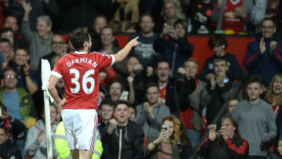 Manchester United's Italian defender Matteo Darmian celebrates after scoring during the English Premier League football match between Manchester United and Crystal Palace at Old Trafford in Manchester, north west England, on April 20, 2016. / AFP / OLI SCARFF / RESTRICTED TO EDITORIAL USE. No use with unauthorized audio, video, data, fixture lists, club/league logos or 'live' services. Online in-match use limited to 75 images, no video emulation. No use in betting, games or single club/league/player publications.  /         (Photo credit should read OLI SCARFF/AFP/Getty Images)