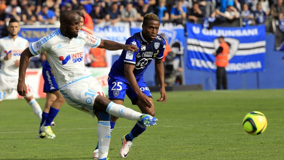 Marseille's French midfielder Lassana Diarra (L) vies with Bastia's Guinean forward Francois Kamano during the French L1 football match Bastia (SCB) against Marseille (OM) on April 3, 2016, at the Armand Cesari stadium in Bastia, on the French Mediterranean island of Corsica.  AFP PHOTO / PASCAL POCHARD-CASABIANCA / AFP / PASCAL POCHARD-CASABIANCA        (Photo credit should read PASCAL POCHARD-CASABIANCA/AFP/Getty Images)