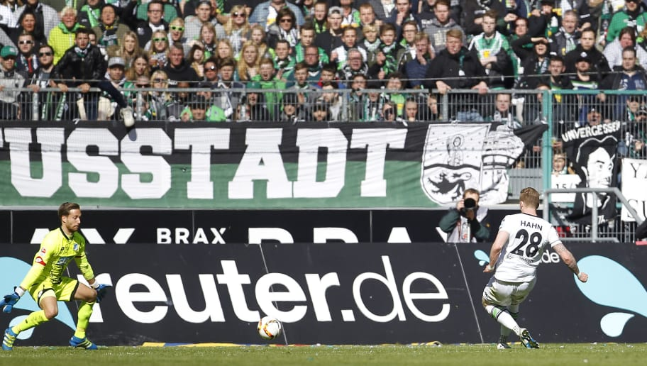 MOENCHENGLADBACH, GERMANY - APRIL 24:  Andre Hahn of Moenchengladbach (R) shots the 3:1 goal against Goalkeeper Oliver Baumann of Hoffenheim during the Bundesliga match between Borussia Moenchengladbach and TSG 1899 Hoffenheim on April 24, 2016 in Moenchengladbach, Germany. (Photo by Mika Volkmann/Bongarts/Getty Images)