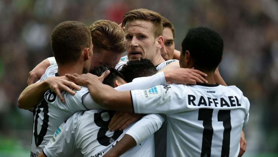 Moenchengladbach's midfielder Mahmoud Dahoud and his teammates celebrate during the German first division Bundesliga football match Borussia Moenchengladbach vs Hoffenheim in Moenchengladbach, western Germany, on April 24, 2016.     / AFP / PATRIK STOLLARZ / RESTRICTIONS: DURING MATCH TIME: DFL RULES TO LIMIT THE ONLINE USAGE TO 15 PICTURES PER MATCH AND FORBID IMAGE SEQUENCES TO SIMULATE VIDEO. == RESTRICTED TO EDITORIAL USE == FOR FURTHER QUERIES PLEASE CONTACT DFL DIRECTLY AT + 49 69 650050         (Photo credit should read PATRIK STOLLARZ/AFP/Getty Images)