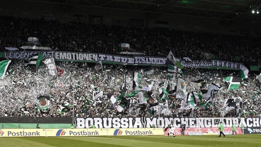 MOENCHENGLADBACH, GERMANY - APRIL 24:  Fans of Gladbach wave their flags prior the Bundesliga match between Borussia Moenchengladbach and TSG 1899 Hoffenheim on April 24, 2016 in Moenchengladbach, Germany. (Photo by Mika Volkmann/Bongarts/Getty Images)
