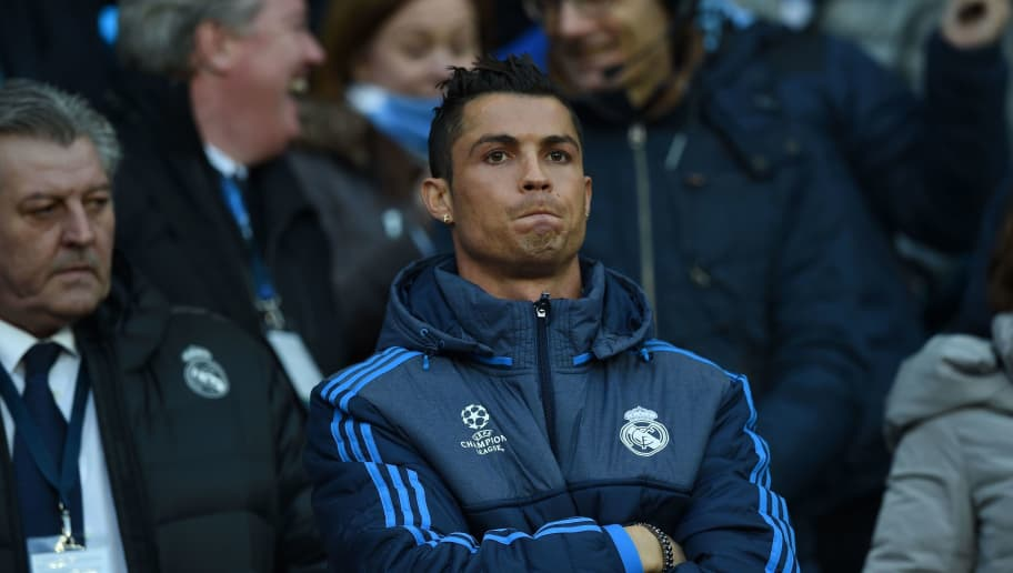 Real Madrid's Portuguese forward Cristiano Ronaldo stands in the crowd as a spectator during the UEFA Champions League semi-final first leg football match between Manchester City and Real Madrid at the Etihad Stadium in Manchester, northwest England, on April 26, 2016. / AFP / PAUL ELLIS        (Photo credit should read PAUL ELLIS/AFP/Getty Images)