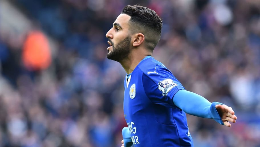 Leicester City's Algerian midfielder Riyad Mahrez celebrates scoring the opening goal during the English Premier League football match between Leicester City and Swansea at King Power Stadium in Leicester, central England on April 24, 2016. / AFP / BEN STANSALL / RESTRICTED TO EDITORIAL USE. No use with unauthorized audio, video, data, fixture lists, club/league logos or 'live' services. Online in-match use limited to 75 images, no video emulation. No use in betting, games or single club/league/player publications.  /         (Photo credit should read BEN STANSALL/AFP/Getty Images)