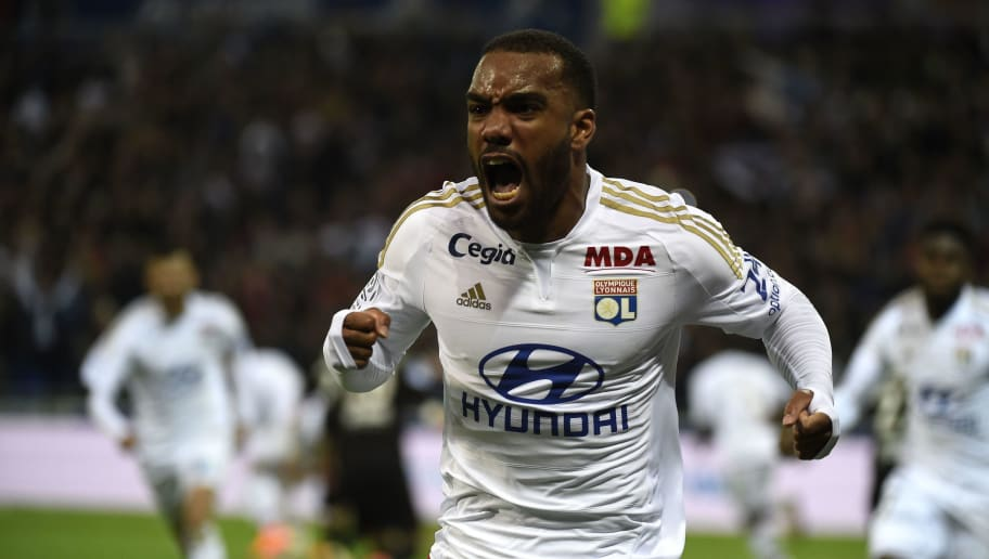 Lyon's French forward Alexandre Lacazette celebrates after scoring during the French L1 football match Olympique Lyonnais and OGC Nice on April 15, 2016, at the New Stadium in Decines-Charpieu near Lyon, southeastern France.      AFP PHOTO/PHILIPPE DESMAZES / AFP / PHILIPPE DESMAZES        (Photo credit should read PHILIPPE DESMAZES/AFP/Getty Images)