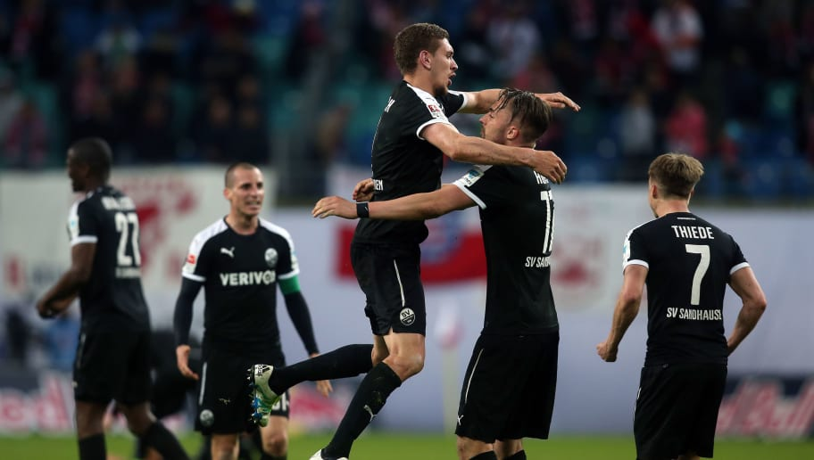 LEIPZIG, GERMANY - APRIL 15:  Damian Rossbach (3rd L) and Florian Huebner (4th L) of Sandhausen celebrate after the Second Bundesliga match between RB Leipzig and SV Sandhausen at Red Bull Arena on April 15, 2016 in Leipzig, Germany.  (Photo by Ronny Hartmann/Bongarts/Getty Images)