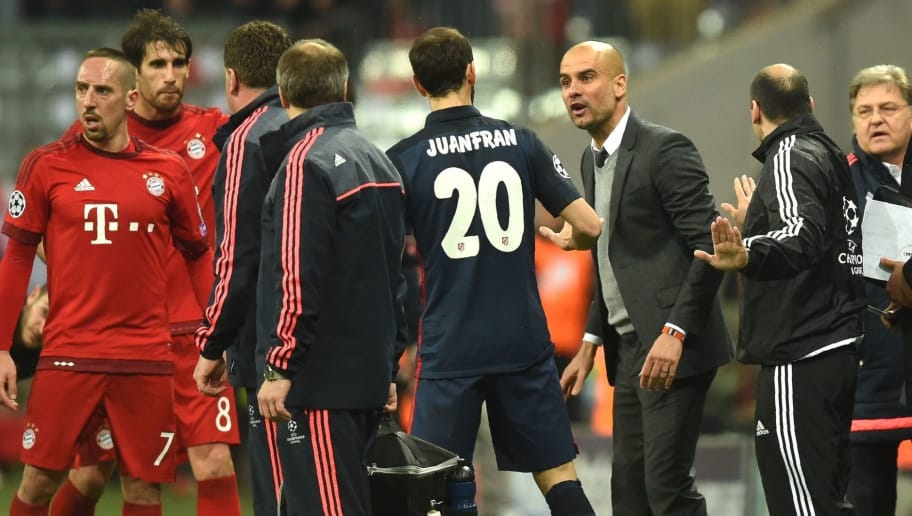 Bayern Munich's Spanish head coach Pep Guardiola (4thR) argues with Atletico Madrid's defender Juanfran (C) during the UEFA Champions League semi-final, second-leg football match between FC Bayern Munich and Atletico Madrid in Munich, southern Germany, on May 3, 2016. / AFP / Christof Stache        (Photo credit should read CHRISTOF STACHE/AFP/Getty Images)