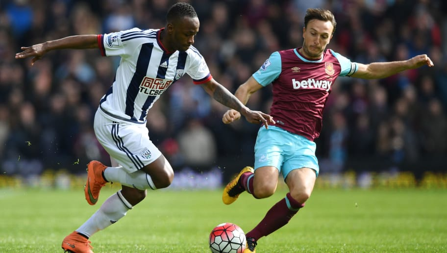 WEST BROMWICH, ENGLAND - APRIL 30:  Saido Berahino of West Bromwich Albion is tackled by Mark Noble of West Ham United during the Barclays Premier League match between West Bromwich Albion and West Ham United at The Hawthorns on April 30, 2016 in West Bromwich, England.  (Photo by Shaun Botterill/Getty Images)