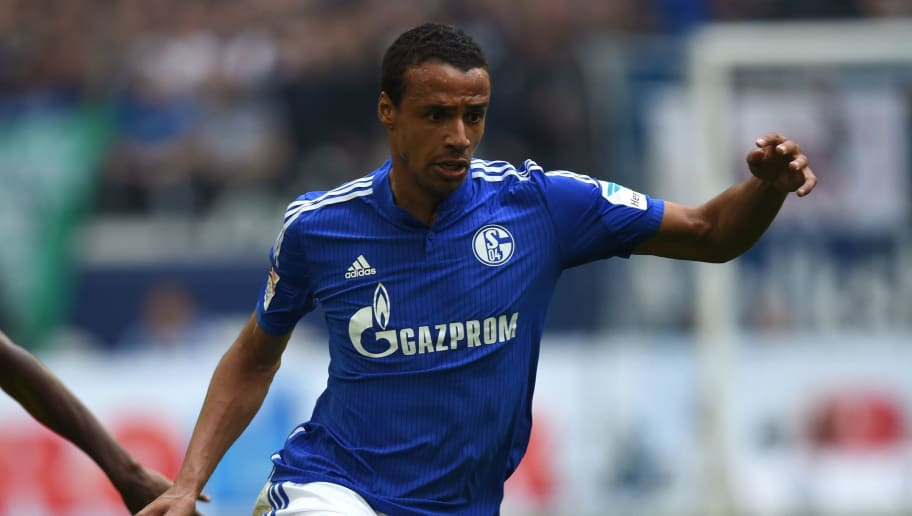 Schalke's Cameroonian defender Joel Matip vies for the ball during the German Bundesliga first division football match between FC Schalke 04 and Borussia Dortmund, in the Veltins Arena in Gelsenkirchen, western Germany, on April 10, 2016.  / AFP / PATRIK STOLLARZ / RESTRICTIONS: DURING MATCH TIME: DFL RULES TO LIMIT THE ONLINE USAGE TO 15 PICTURES PER MATCH AND FORBID IMAGE SEQUENCES TO SIMULATE VIDEO. == RESTRICTED TO EDITORIAL USE == FOR FURTHER QUERIES PLEASE CONTACT DFL DIRECTLY AT + 49 69 650050         (Photo credit should read PATRIK STOLLARZ/AFP/Getty Images)