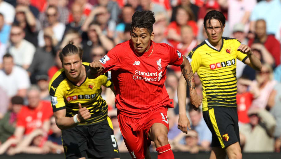 Liverpool's Brazilian midfielder Roberto Firmino (C) runs during the English Premier League football match between Liverpool and Watford at Anfield in Liverpool, north west England on May 8, 2016. / AFP / LINDSEY PARNABY / RESTRICTED TO EDITORIAL USE. No use with unauthorized audio, video, data, fixture lists, club/league logos or 'live' services. Online in-match use limited to 75 images, no video emulation. No use in betting, games or single club/league/player publications.  /         (Photo credit should read LINDSEY PARNABY/AFP/Getty Images)