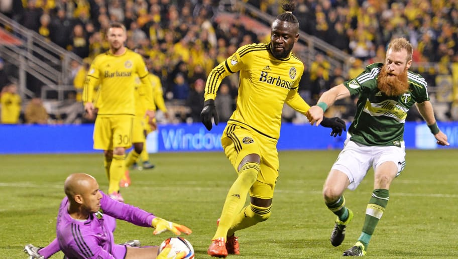 COLUMBUS, OH - DECEMBER 6:  Goalkeeper Adam Kwarasey #12 of the Portland Timbers slides in to take control of the ball as Kei Kamara #23 of the Columbus Crew SC and Nat Borchers #7 of the Portland Timbers move in in the second half on December 6, 2015 at MAPFRE Stadium in Columbus, Ohio. Portland defeated Columbus Crew SC 2-1 to claim the MLS Cup title.  (Photo by Jamie Sabau/Getty Images)