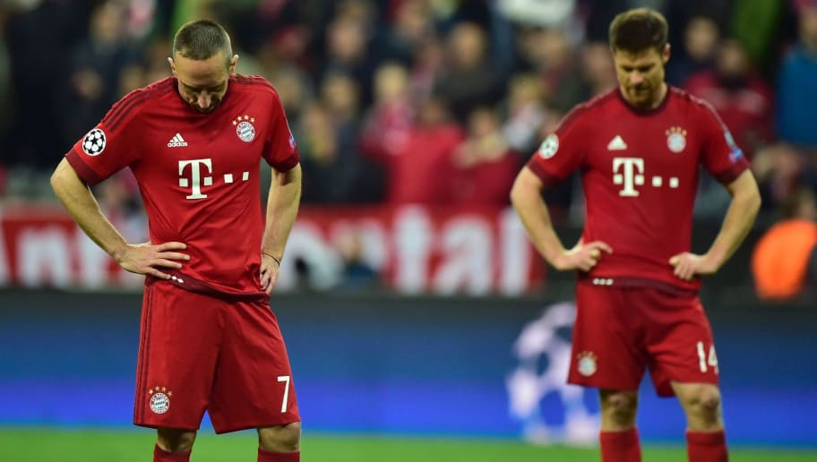 Bayern Munich's French midfielder Franck Ribery (L) and Bayern Munich's Spanish midfielder Xabi Alonso react after the UEFA Champions League semi-final, second-leg football match between FC Bayern Munich and Atletico Madrid in Munich, southern Germany, on May 3, 2016. / AFP / John MACDOUGALL        (Photo credit should read JOHN MACDOUGALL/AFP/Getty Images)