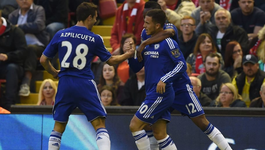 Chelsea's Belgian midfielder Eden Hazard (C) celebrates with Chelsea's Spanish defender Cesar Azpilicueta (L) and Chelsea's Nigerian midfielder John Obi Mikel after scoring the opening goal of the English Premier League football match between Liverpool and Chelsea at Anfield in Liverpool, north west England on May 11, 2016. / AFP / Paul ELLIS / RESTRICTED TO EDITORIAL USE. No use with unauthorized audio, video, data, fixture lists, club/league logos or 'live' services. Online in-match use limited to 75 images, no video emulation. No use in betting, games or single club/league/player publications.  /         (Photo credit should read PAUL ELLIS/AFP/Getty Images)