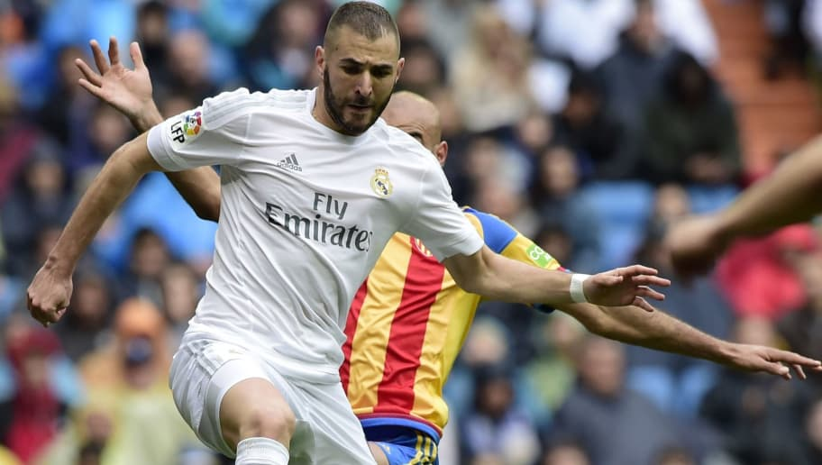 Real Madrid's French forward Karim Benzema (L) vies with Valencia's Tunisian defender Aymen Abdennour during the Spanish league football match Real Madrid CF vs Valencia CF at the Santiago Bernabeu stadium in Madrid on May 8, 2016. / AFP / JAVIER SORIANO        (Photo credit should read JAVIER SORIANO/AFP/Getty Images)
