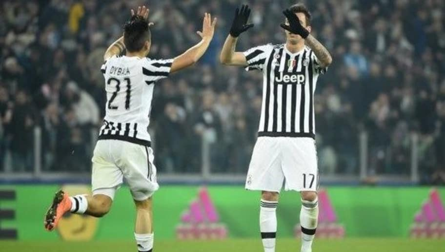 Juventus' Argentinian forward Paulo Dybala (L) celebrates with Juventus' Croatian forward Mario Mandzukic after scoring a goal during the UEFA Champions League round of 16 first leg football match between Juventus and Bayern Munich at the Juventus Stadium in Turin on February 23, 2016