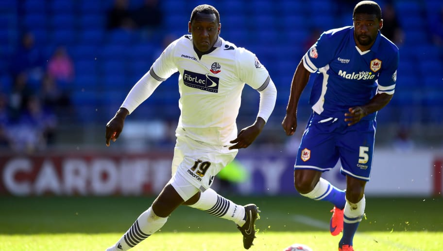 CARDIFF, WALES - APRIL 06:  Bolton player Emile Heskey (l) is challenged by Bruno Ecuele - Manga of Cardiff during the  Sky Bet Championship match between Cardiff City and Bolton Wanderers at Cardiff City Stadium on April 6, 2015 in Cardiff, Wales.  (Photo by Stu Forster/Getty Images)