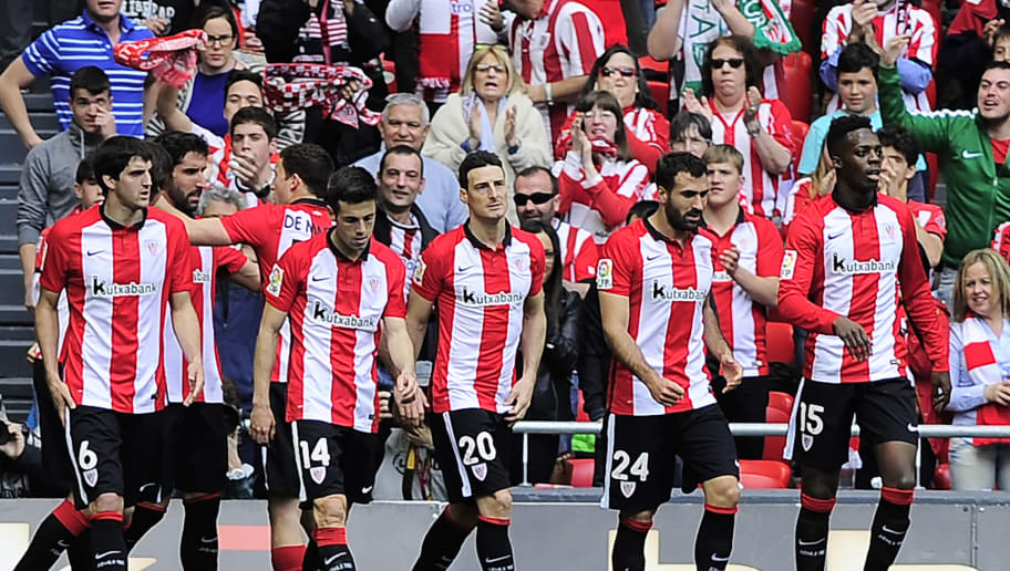 Athletic Bilbao players celebrate after scoring during the Spanish league football match Athletic Club de Bilbao vs RC Celta de Vigo at the San Mames stadium in Bilbao on May 1, 2016. / AFP / ANDER GILLENEA        (Photo credit should read ANDER GILLENEA/AFP/Getty Images)