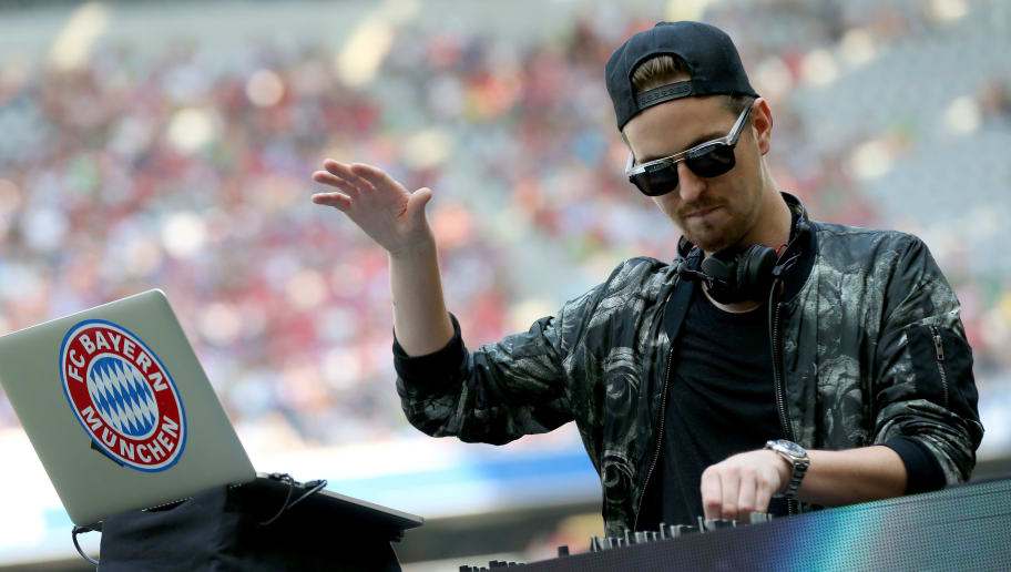 MUNICH, GERMANY - JULY 11:  DJ Robin Schulz performes during the FC Bayern Muenchen season opening and team presentation at Allianz Arena on July 11, 2015 in Munich, Germany.  (Photo by Alexander Hassenstein/Bongarts/Getty Images)