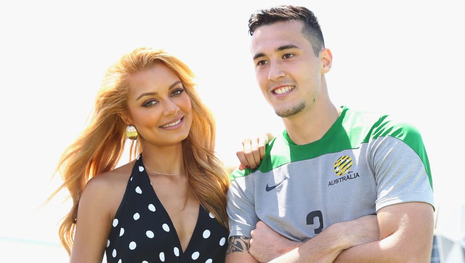 MELBOURNE, AUSTRALIA - JANUARY 04:  Australian singer and DJ Havana Brown poses with Socceroo Jason Davidson, after an Australian Socceroos training session at Collingwood training Ground on January 4, 2015 in Melbourne, Australia. Havana Brown will perfom at the opening ceremony of the 2015 AFC Asian Cup football tournamanet.  (Photo by Robert Cianflone/Getty Images)
