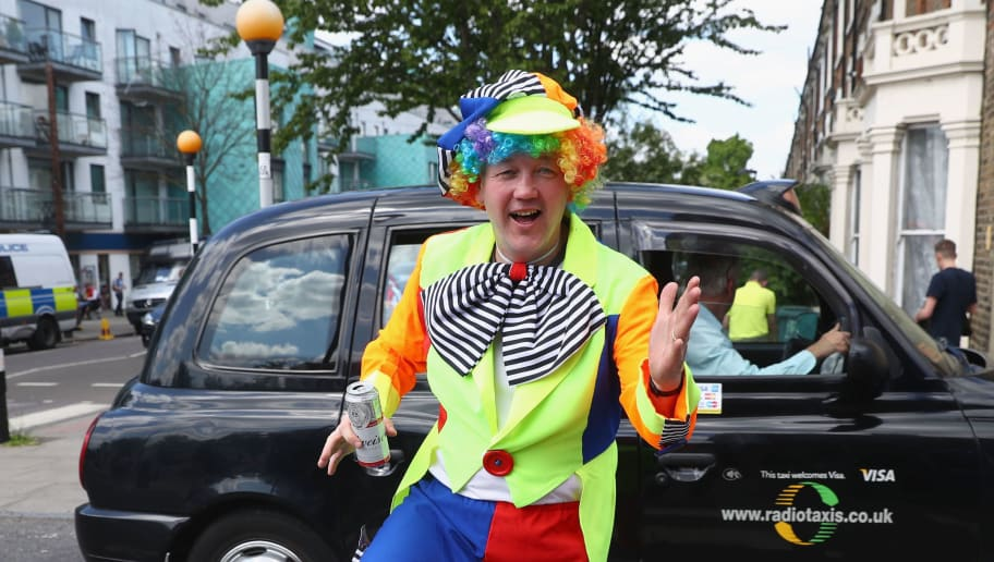 LONDON, UNITED KINGDOM - MAY 15: A fan dressed as a clown walks towards the ground prior to the Barclays Premier League match between Arsenal and Aston Villa at Emirates Stadium on May 15, 2016 in London, England.  (Photo by Julian Finney/Getty Images)