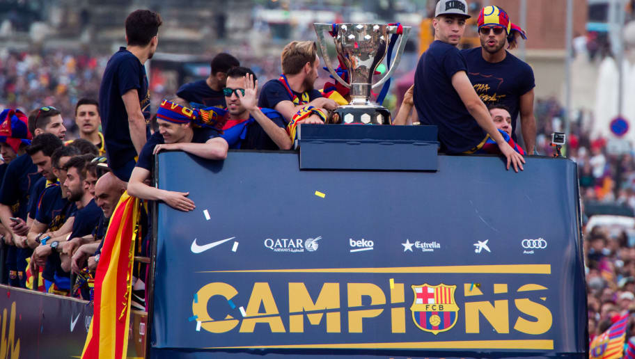 BARCELONA, SPAIN - MAY 15:  FC Barcelona players celebrate on an open top bus during their victory parade after winning the Spanish La Liga on May 15, 2016 in Barcelona, Spain.  (Photo by Alex Caparros/Getty Images)