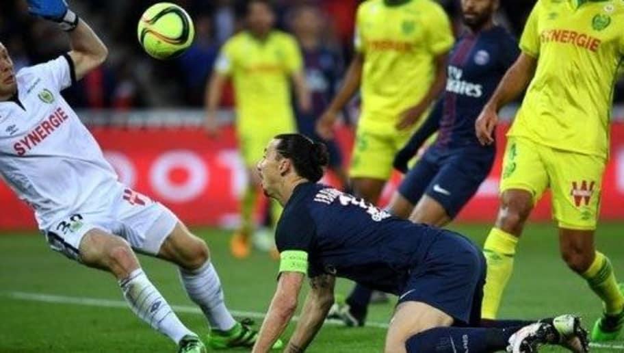 Paris Saint-Germain's Swedish forward Zlatan Ibrahimovic (C) scores a goal during the French L1 football match between Paris Saint-Germain and Nantes at the Parc des Princes stadium in Paris on May 14, 2016