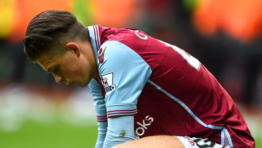 BIRMINGHAM, ENGLAND - APRIL 23:  Jack Grealish of Aston Villa looks dejected during the Barclays Premier League match between Aston Villa and Southampton at Villa Park on April 23, 2016 in Birmingham, United Kingdom.  (Photo by Laurence Griffiths/Getty Images)