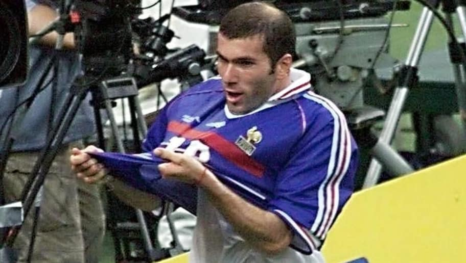 French midfielder Zinedine Zidane lifts his jersey after scoring a goal for his team, 12 July during the 1998 World Cup final match Brazil vs France, at the Stade de France in Saint-Denis. (ELECTRONIC IMAGE) AFP PHOTO PASCAL GEORGE        (Photo credit should read PASCAL GEORGE/AFP/Getty Images)