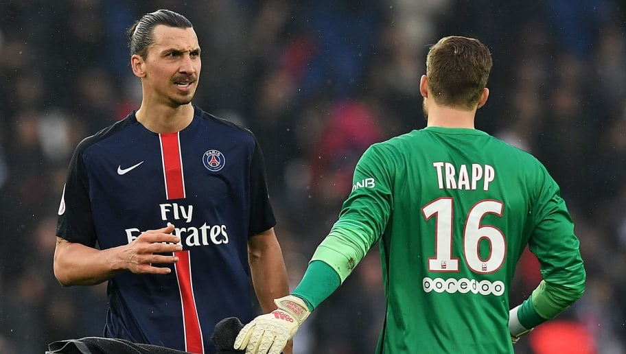Paris Saint-Germain's Swedish forward Zlatan Ibrahimovic (L) and Paris Saint-Germain's German goalkeeper Kevin Trapp react at the end of the French L1 football match between Paris Saint-Germain and Nice at the Parc des Princes stadium in Paris on April 2, 2016.  Patris won 4-1. AFP PHOTO / FRANCK FIFE / AFP / FRANCK FIFE        (Photo credit should read FRANCK FIFE/AFP/Getty Images)