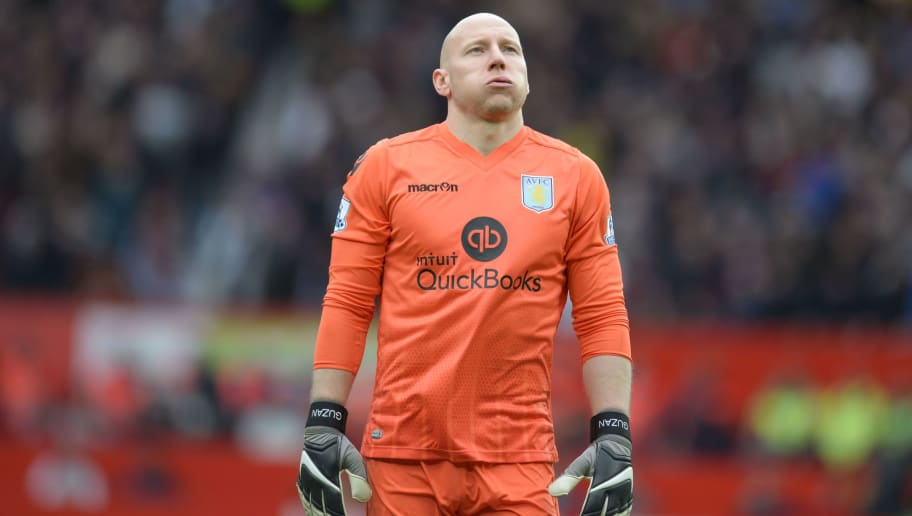 Aston Villa's US goalkeeper Brad Guzan reacts during the English Premier League football match between Manchester United and Aston Villa at Old Trafford in Manchester, north west England, on April 16, 2016. / AFP / OLI SCARFF / RESTRICTED TO EDITORIAL USE. No use with unauthorized audio, video, data, fixture lists, club/league logos or 'live' services. Online in-match use limited to 75 images, no video emulation. No use in betting, games or single club/league/player publications.  /         (Photo credit should read OLI SCARFF/AFP/Getty Images)