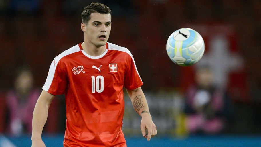 Swiss midfielder Granit Xhaka eyes the ball during the friendly football match between Switzerland and Bosnia-Herzegovina at Letzigrund Stadium in Zurich on March 29, 2016. / AFP / FABRICE COFFRINI        (Photo credit should read FABRICE COFFRINI/AFP/Getty Images)