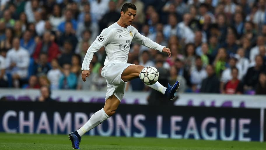 TOPSHOT - Real Madrid's Portuguese forward Cristiano Ronaldo controls the ball during the UEFA Champions League semi-final second leg football match Real Madrid CF vs Manchester City FC at the Santiago Bernabeu stadium in Madrid, on May 4, 2016. / AFP / PAUL ELLIS        (Photo credit should read PAUL ELLIS/AFP/Getty Images)