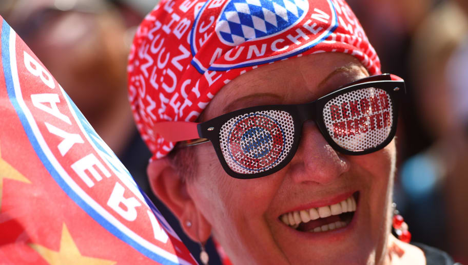 MUNICH, GERMANY - MAY 22: A fan of FC Bayern Muenchen celebrates winning the German Championship and the DFB Cup 2016 on the town hall balcony at Marienplatz on May 22, 2016 in Munich, Germany.  (Photo by Lennart Preiss/Bongarts/Getty Images)